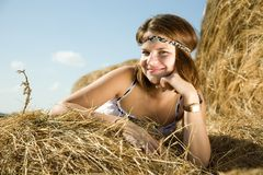 Country girl on fresh hay Stock Photo