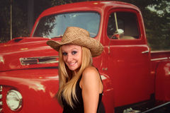 Country girl in front of an old pickup truck Royalty Free Stock Images