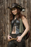 Country girl with guitar. Pretty country girl with guitar on the ranch Royalty Free Stock Photography