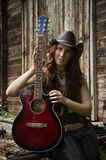 Country girl with guitar Royalty Free Stock Photo