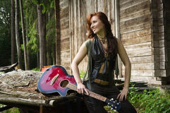 Country girl with guitar Stock Image