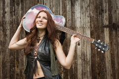 Country girl with guitar Stock Photography