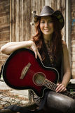 Country girl with guitar Stock Photo