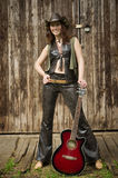 Country girl with guitar Royalty Free Stock Images
