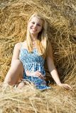 Country girl on hay Royalty Free Stock Photo