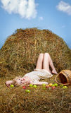 Country girl on hay Royalty Free Stock Photography