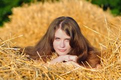 Country girl on hay Stock Images