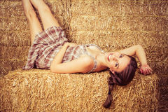 Country Girl in Hay Royalty Free Stock Images