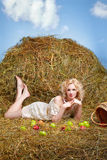 Country girl on hay Royalty Free Stock Photos