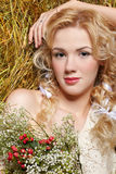 Country girl on hay Royalty Free Stock Image