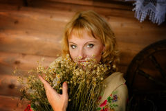 Country girl with herbs Stock Image