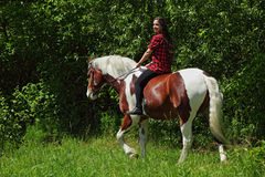Country girl on horseback in the forest Stock Photo