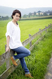 Country girl leaning on a fence Stock Photography