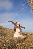 Country girl  play with hay  against sky Stock Images