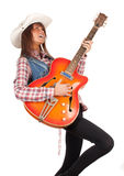 Country girl playing on electric guitar Royalty Free Stock Photos
