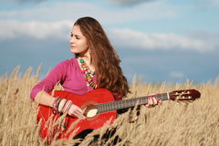 Country girl playing guitar Stock Photos