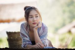 Country girl. Portrait in outdoors,Happy rural girl smiling in field,portrait of a happy young asian woman Royalty Free Stock Photos