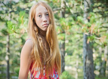 Country girl. Portrait of young redhead girl, outdoot shot in forest Stock Image