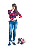 Country girl with a pug dog Stock Photos