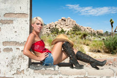 Country girl resting in desert Stock Photos