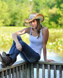 Country girl sitting on dock Royalty Free Stock Images