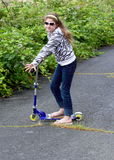 Country Girl on Skate Scooter Royalty Free Stock Photos