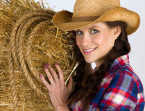 Country Girl Smiling Holding Straw Bale & Rope stock photos
