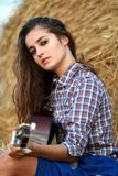 Country girl strumming a guitar Stock Photography