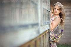 Country girl in summer dress with a basket. Country girl in provence style dress with a basket of wild flowers Stock Photos