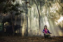 Country girl. Young country girl portrait outdoors.Asian woman in outdoor nature farm.Beautiful rural girl in tribal costume dress working at countryside royalty free stock photo