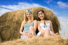Country girls on hay Stock Image