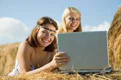 Country girls with laptop Stock Images