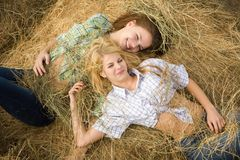 Country Girls Laying On Hay Royalty Free Stock Image