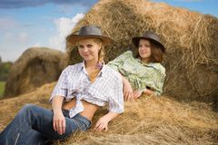 Country Girls Laying On Hay Stock Photo