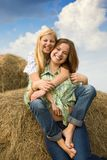 Country girls  play on hay Royalty Free Stock Photography