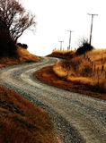 Country gravel backroad. Gravel backroad with telephone lines in the Gibbston Valley wine area in Otago, New Zealand stock images