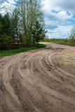 country gravel road with old and broken asphalt royalty free stock images