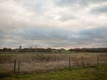 Country green grassland plain field white clouds sky empty space. Essex; england; uk royalty free stock photo