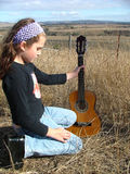 Country Guitar. Girl holding a guitar stock images