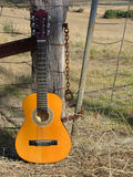 Country Guitar. Guitar on post royalty free stock images