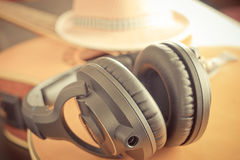 Country Guitar with hat and headphone. Country acoustic Guitar with hat and headphone Royalty Free Stock Photos
