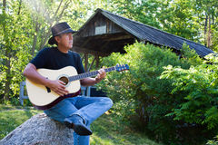 Country Guitar player at covered bridge Royalty Free Stock Photo