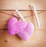 Country hearts on wooden pegs Royalty Free Stock Image