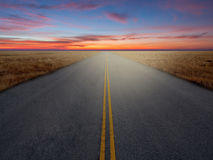 Country Highway. At sunset time royalty free stock photo