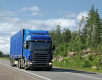 Country highway and blue truck. Blue truck on summer country highway Royalty Free Stock Image