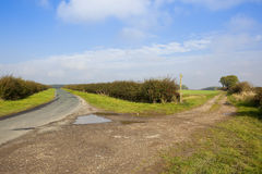 Country highway and farm track Stock Image