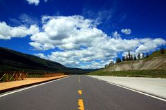 Country highway. Highway and sky with clouds Stock Image