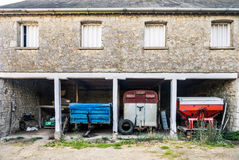 Country home with agricultural machines Royalty Free Stock Photo