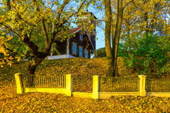 Country Home on Knoll In Autumn Stock Photo