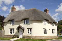 Country home with thatched roof Royalty Free Stock Photography